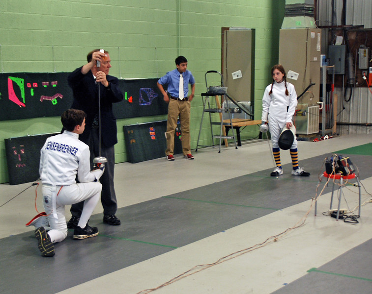 Referee Allan Barwick checks the Jean-Luc Sensenbrenner's epee before competing against Emma Scala.