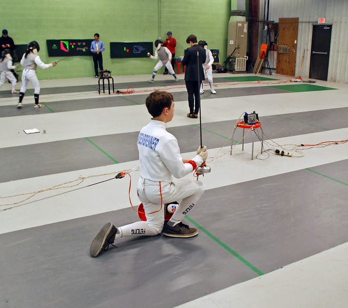 Jean-Luc Sensenbrenner prepares to fence in the gold medal bout.