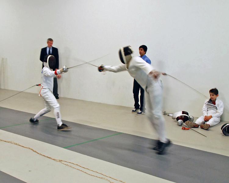 Arnold Wynn (right) vs. Jean-Luc Sensenbrenner.