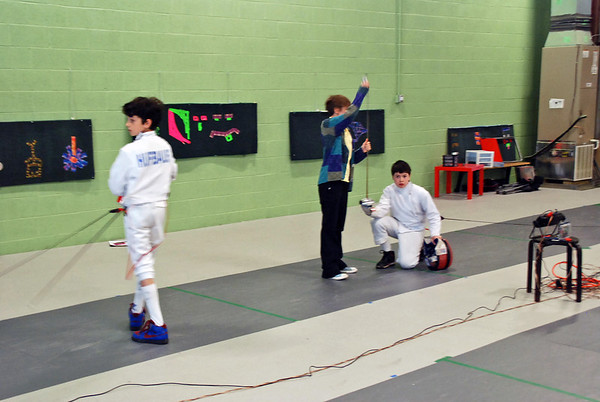The referee checks the epee of Rory Hagerty before bouting against Romain Hufbauer.