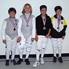 The medal winners in the Youth-12 & Under Mixed Foil: from right, Raphael Sitbon-Taylor (1st), Roshan Talagala (2nd), Quin Spey (3rd) and Simon Gershunskiy (3rd).