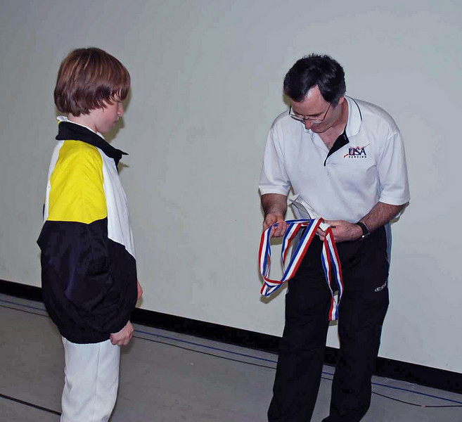 Jacob Roberts receives his 3rd place medal in the Youth-12 & Under Mixed Epee.