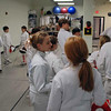 The epee fencers gather before the start of the tournament.