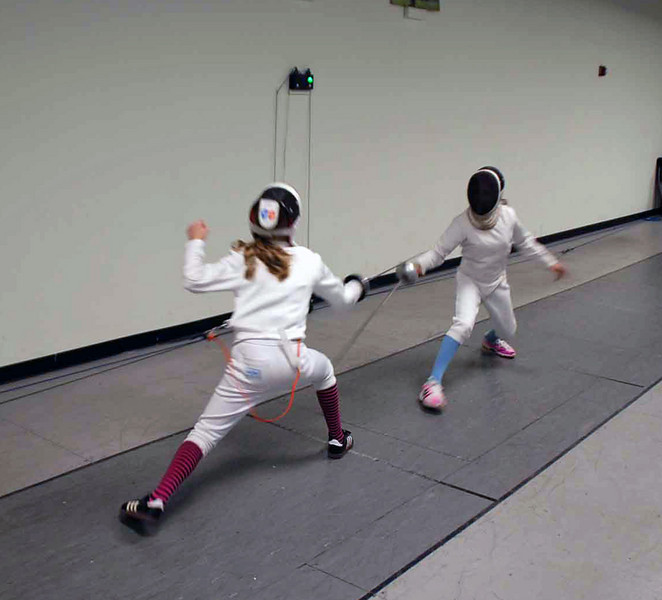 Lizzie Wiggins scores on Lindy Hill in the gold medal bout.
