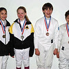 The medalists in the Y12 & Under Mixed Epee.  From left: Elizabeth Wiggins (1st), Linden Hill (2nd), Jacob Asher (3rd), Quinn Blumberg (3rd).
