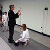 Maddy Parker has her epee checked by the referee.