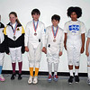 The top 8 of the Y12 & Under Mixed Epee Tournament.  From left: Elizabeth Wiggins (1st), Linden Hill (2nd), Jacob Asher (3rd), Quinn Blumberg (3rd), Mikaela Farrugia (5th, not pictured), Cole Srere (6th), Romain Hufbauer (7th), Benjamin Farber (8th, not pictured).