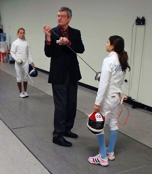 Referee Malcolm Patterson checks the Lizzie Wiggins' epee.