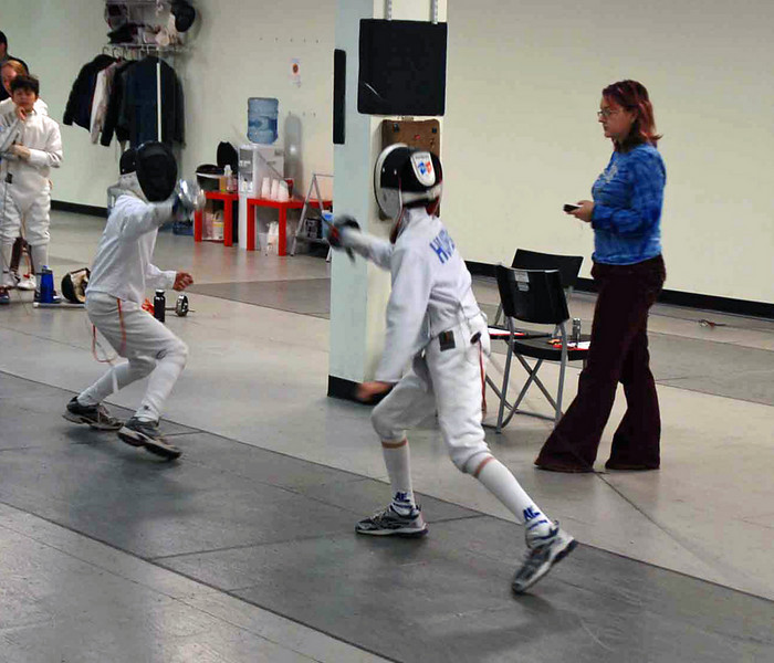 Romain Hufbauer (right) fences in the Y12 & Under Mixed Epee Tournament.