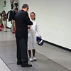 The referee checks Maddy Parker's epee.
