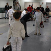 The referee checks the epee of Campbell Clark in his first tournament.