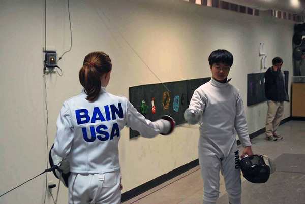 Juliana Bain checks guards at the start of the gold medal bout.