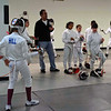 The Chevy Chase Fencing Club fencers warm up before the start of the tournament.