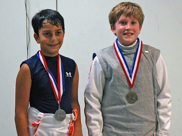 The top foil fencers, from left, Roshan Talagala (2nd) and John Carome (1st).