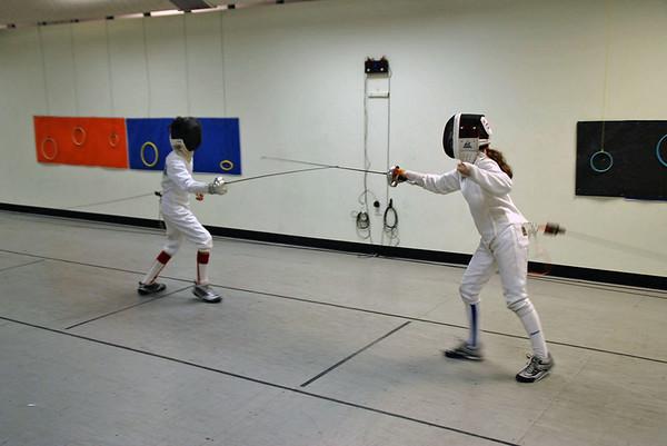 Victor Teelucksingh (left) vs. Elizabeth Wiggins.