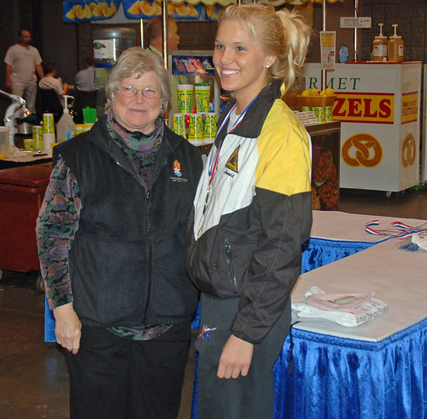 Annie Stephenson receives the 3rd place medal in Cadet Women's Epee from Nancy Anderson, USFA President.