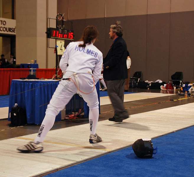 Katharine Holmes stretches before the start of the direct elimination in the Junior Women's Epee.