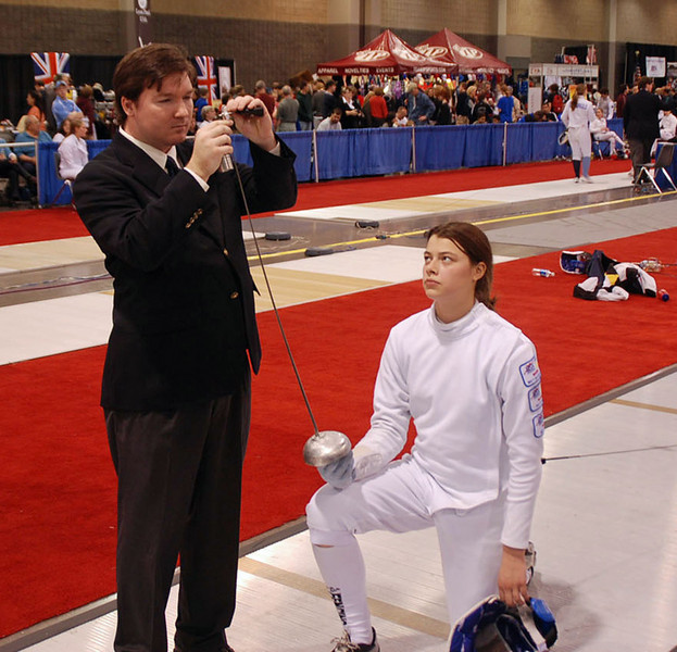 Referee checks Katharine Holmes' epee in the Junior Women's Epee.