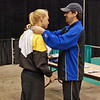 Annie Stephenson receiving her award from Michael Marx.  Annie took 7th place (out of 87 entries) in Cadet Women's Epee.