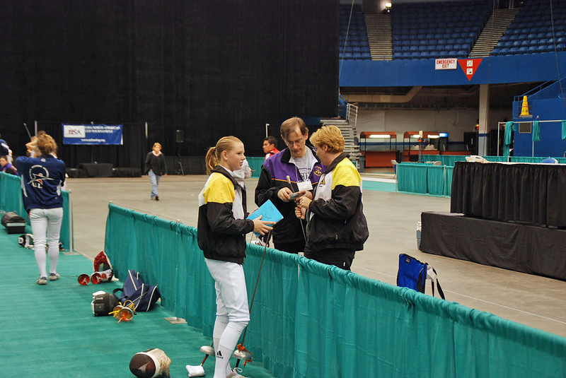 Channing Foster conferring with Coach Jean Finkleman and Kerry <br /> Swick (Coach of Baltimore Fencing <br /> Club, Columbia).