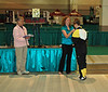 Lena Abraham receiving her 3rd place medal in Division III Women's Foil from Ashley Razo.