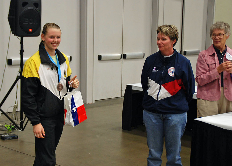Channing Foster receives the 7th Place Medal in the Cadet Women's Epee.