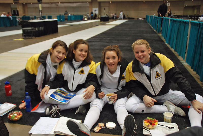 The Chevy Chase Fencing Club Y14 Women's Epee Team, from left, Katharine Holmes, Nina Moiseiwitsch, Ella Barnes, Channing Foster.