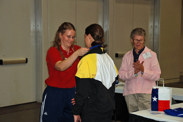 Katharine Holmes receiving the 1st Place Medal in the Y14 Women's Epee.