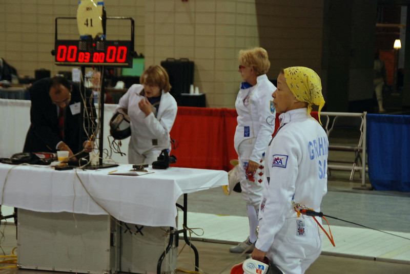 Bettie Graham waits for her bout in the Veteran 60+ Women's Epee.