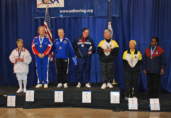 The finalists in the Veteran 60+ Women's Foil.  From left: Judith Evans (6th), Patricia Bedrosian (3rd), Ellen O'Leary (1st), Linda Nowell (2nd), Aeran Lee (3rd), Bettie Graham (5th), Sarah Lawrence (7th).