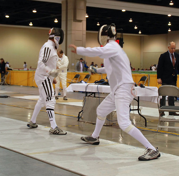 Mark Henry, right, versus Ray Sexton in the Veteran 60+ Men's Epee.