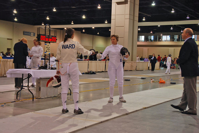 Beth Ward tests guards in her Veteran 50-59 Women's Epee direct elimination bout versus Margo Szabunia.