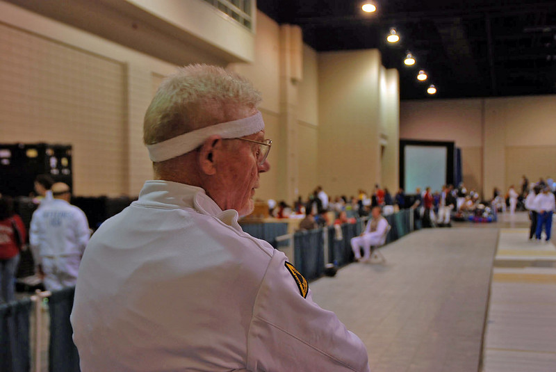 John Hyslop surveying his opponents in the Veteran 60+ Men's Epee.