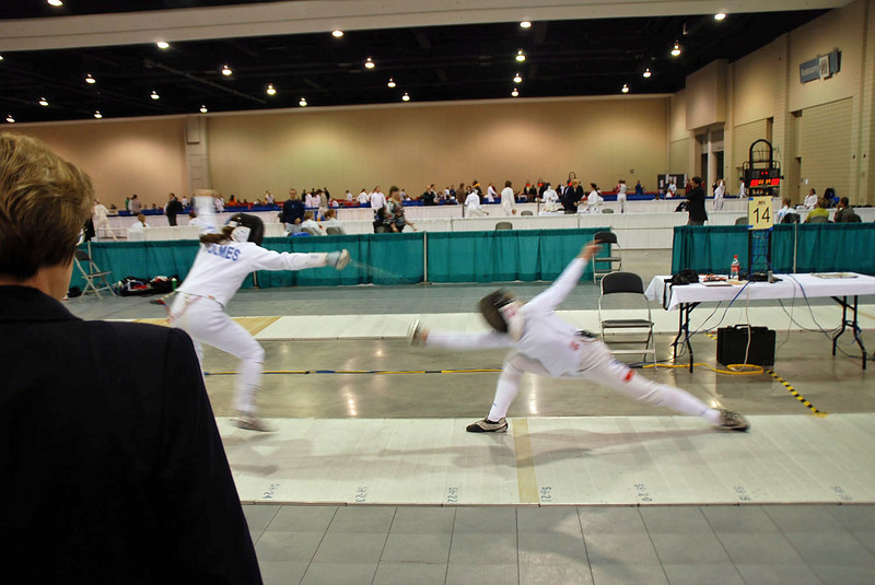 Katharine Holmes, left, in the Division I Women's Epee.  Katharine was undefeated in her pool and seeded 9th into the direct elimination round.