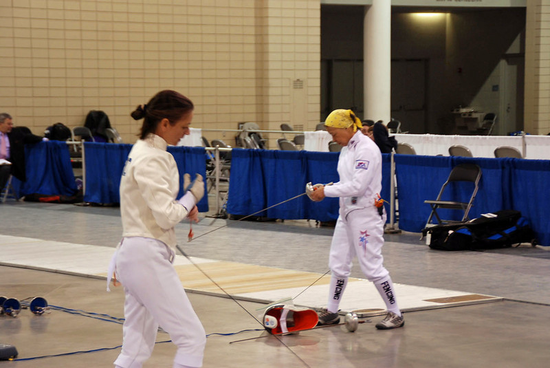 Beth Ward (left) and Bettie Graham hooking up on different strips at the same time in the Veteran Women's Epee.