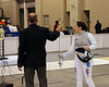 The referee tests Emily Cross' foil.  Emily is the best women's foil fencer in the US.