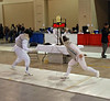 Aeran Lee, right, scores in the Veteran 60+ Women's Foil.