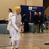 Bettie Graham in the Veteran 60+ Women's Foil (George Kolombatovich, Columbia University Coach and international referee, on the far right).