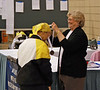 Bettie Graham receives the 3rd place medal in Veteran 60+ Women's Epee from Nancy Anderson, USFA President.