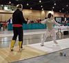 Coach Jean Finkleman gives a warm-up lesson to Aeran Lee before the Veteran Women's Foil.