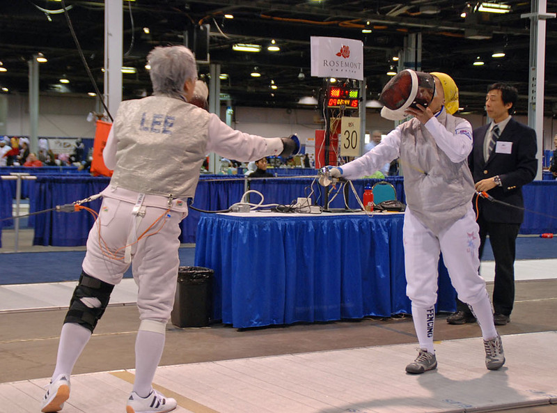 Aeran Lee and Bettie Graham fence each other in the Veteran 60+ Women's Foil.