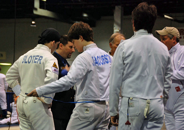 The pool huddle before the start of Division II Men's Epee.