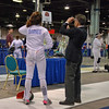 Referee Rick Mayers tests Ella Barnes epee in the Division III Women's Epee.