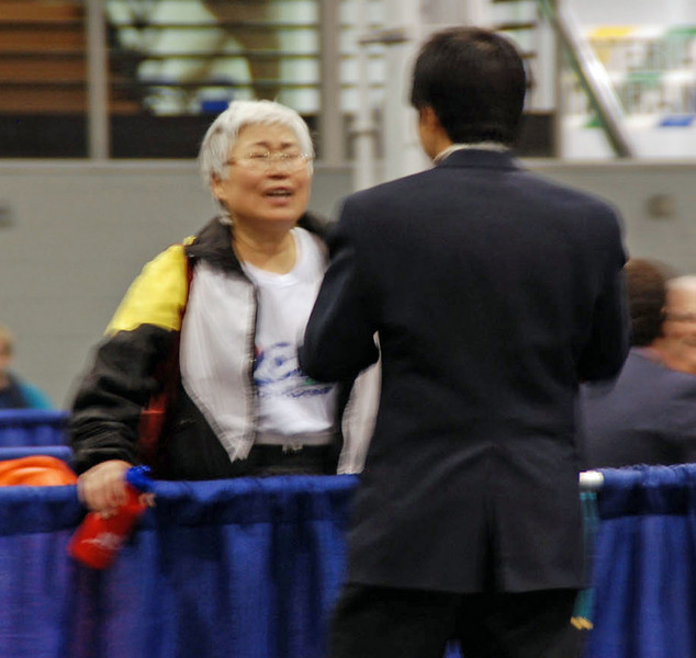 Aeran Lee speaks with one of the referees after the Vet 60+ Women's Foil.