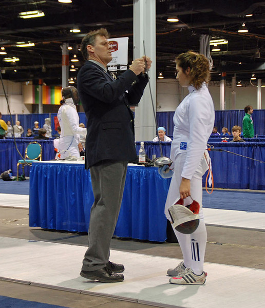 Referee James Bookwalter tests Ella Barnes' epee in the Division II Women's Epee.