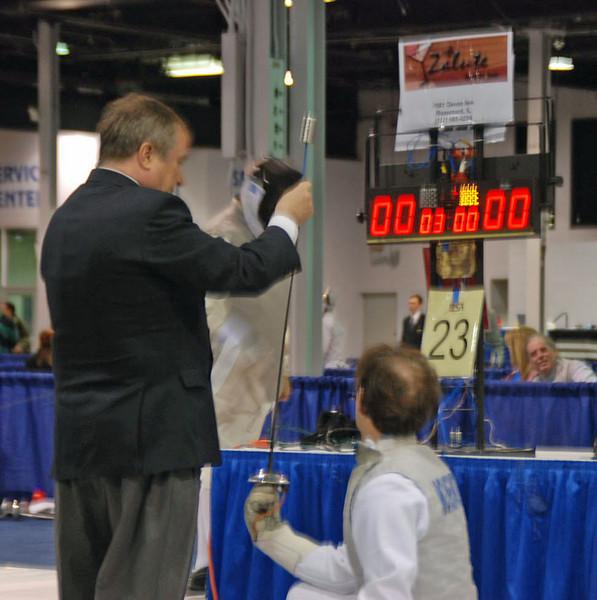 Referee tests Julian Moiseiwitsch's foil.