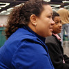 Melanie Carr and her son, Seth Flanagan, watch Katharine Holmes in the Youth-14 Women's Epee.