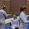 Annie Stephenson talks to her friend Phoebe Caldwell before the Division I Women's Epee.