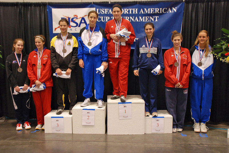 The finalists in the Division I Women's Epee National Championship.  From left, Lauren Willock (7th), Lindsay Campbell (5th), Katharine Holmes (3rd), Hannah Safford (2nd), Courtney Hurley (1st), Francesca Bassa (3rd), Kelley Hurley (6th), and Grace Neveu (8th).