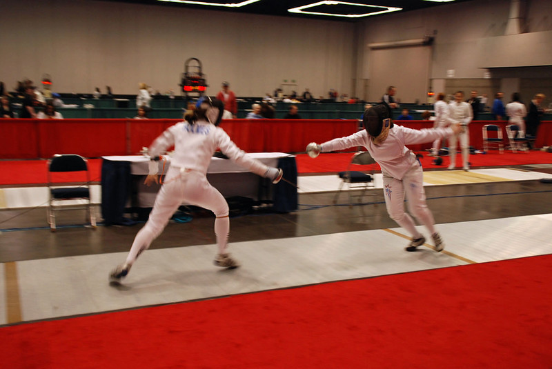 Katharine Holmes (left) fencing in the Division I Women's Epee.